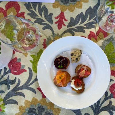 Decorative tablecloth with appetizers and wine glasses