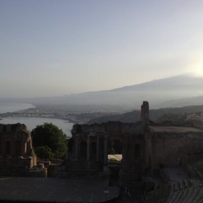 Mount Etna and amphitheater ruins